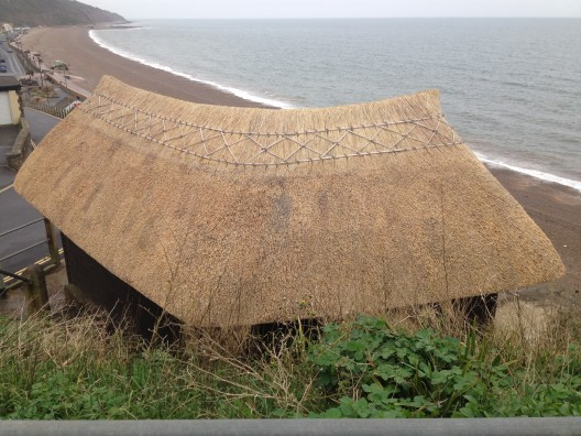 Thatched cliff-top shelter overlooking Seaton beach